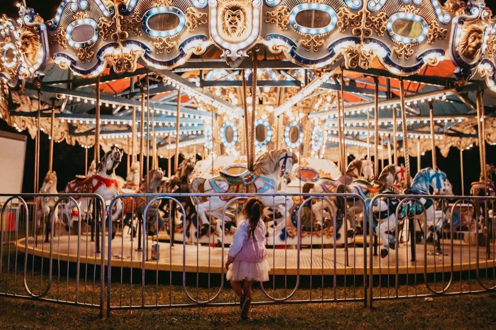 Child standing in front of a Carousel